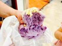 """A """"taro balloon."""" It didn't have much taro or any other flavor; mostly tasted like bread with a little bit of hardened glaze and a few almonds on top."""