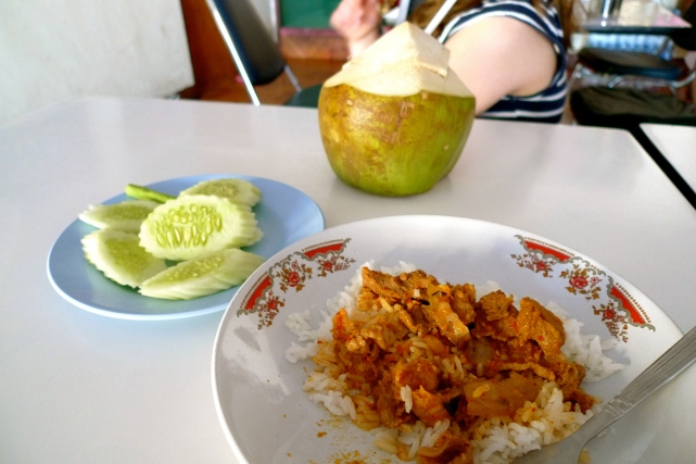 I had this same dish for breakfast twice, from a readymade food stall around the corner from our hotel. Each time I was warned away from it due to the spiciness, but I just loved it. Strips of tender pork (and thin slices of crunchy-crisp gristle) in a heavily spiced curry. Those cold cucumbers and raw long beans were necessary accompaniments.